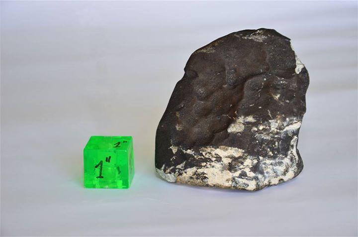 San Carlos meteorite next to 1 inch scale cube / photo: Departamento de Astronomía, Facultad de Ciencias, Universidad de la República, URUGUAY
