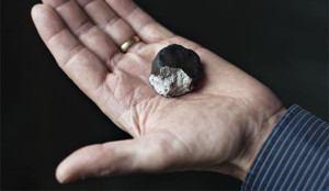 Dr Haack holding the largest fragment of the Ejby meteorite